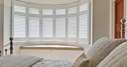 Full height curved bay window shutters