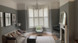 Full height bay window shutter with midrail divide