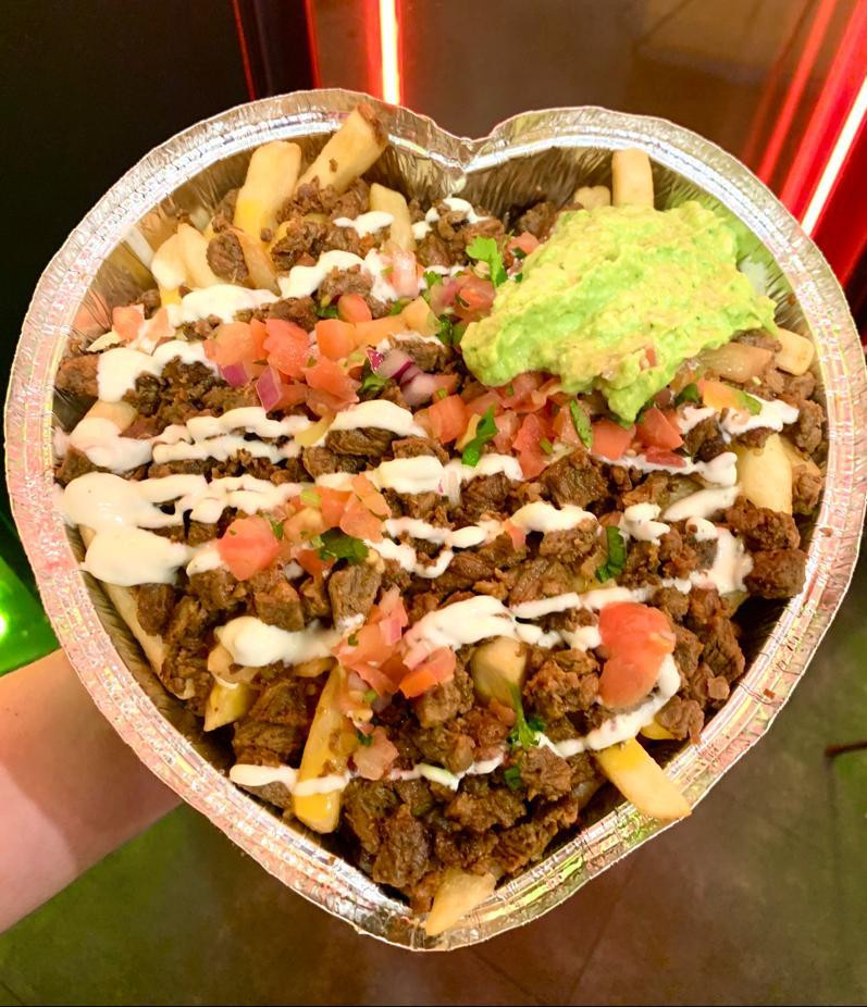 Giant plate of fish tacos in the heart shaped container