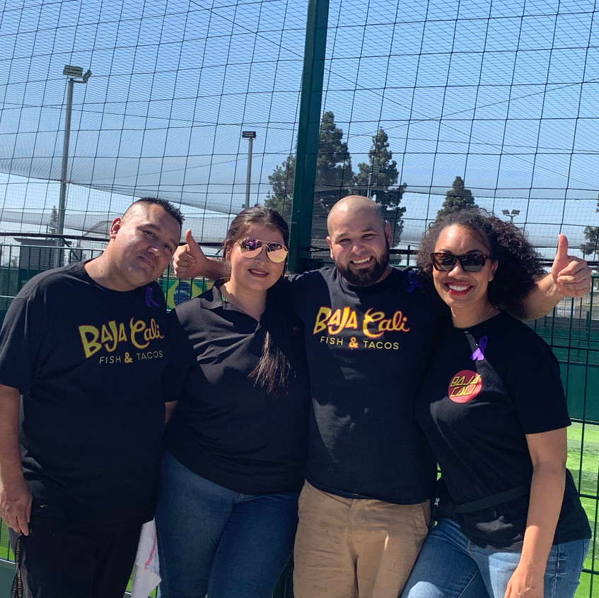 Baja Cali and YWCA of San Gabriel valley Fundraising event with four members smiling