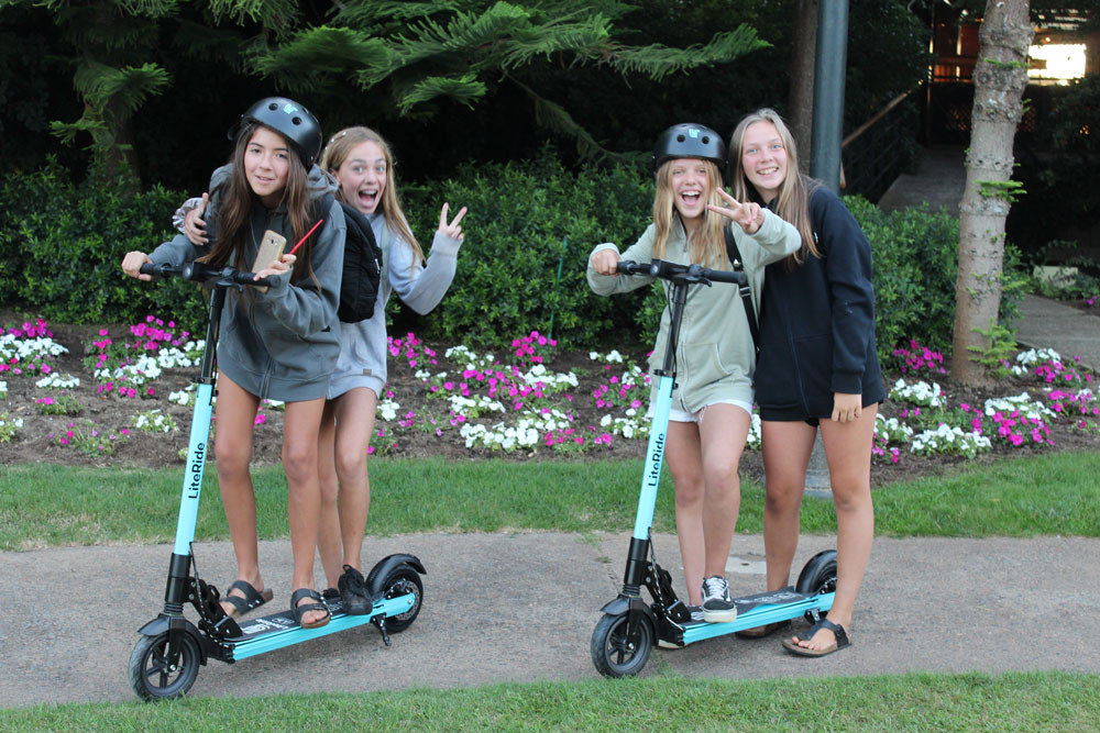 "alt = ""fours girls on scooters"""