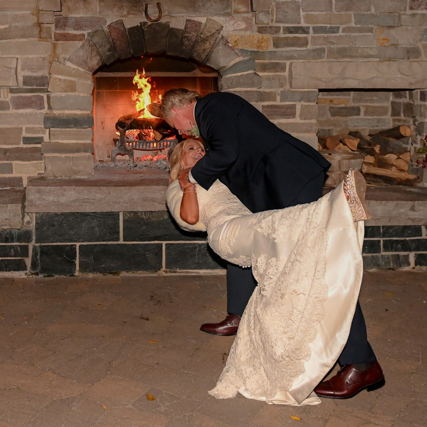 Groom sweeps Bride off her feet during first dance