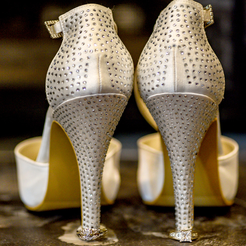 Crystal encrusted white satin wedding shoes
