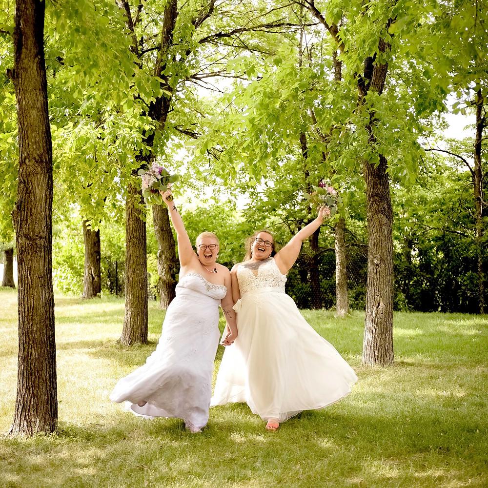 Happy wedding couple in the park