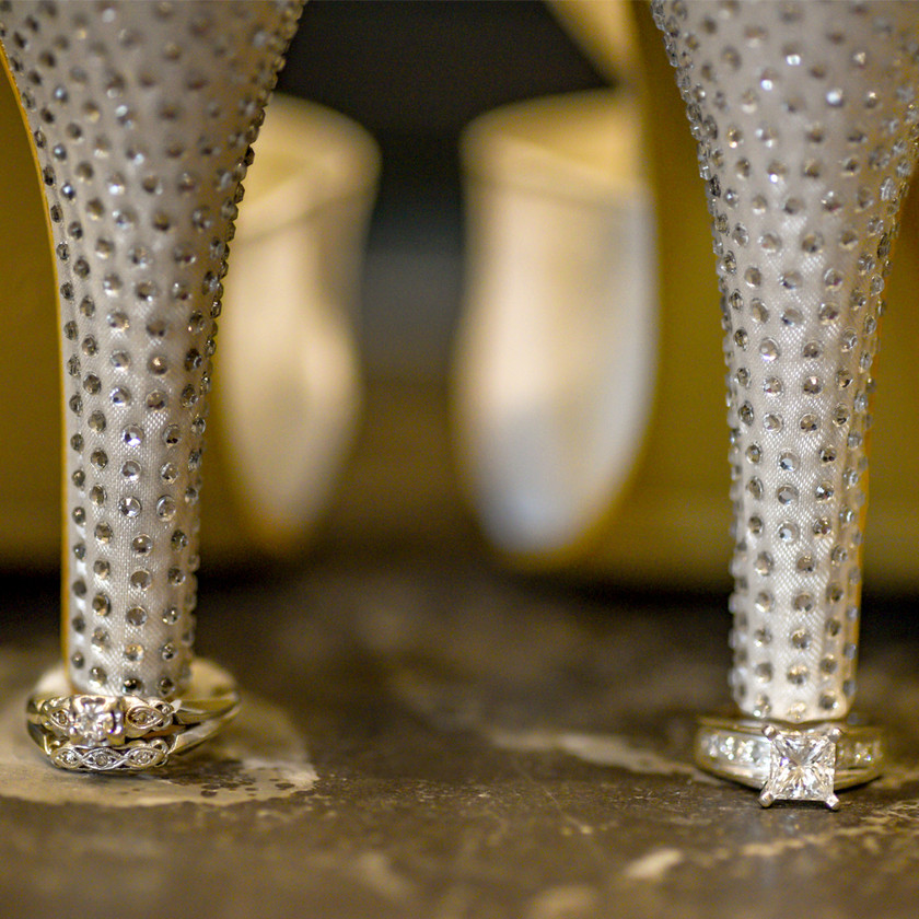 Close up of wedding shoes with wedding rings