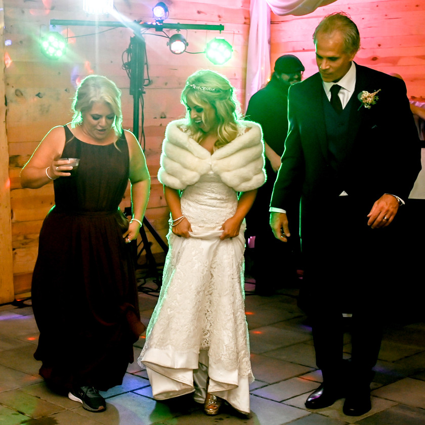Bride and Groom learn new dance moves from Maid of Honor