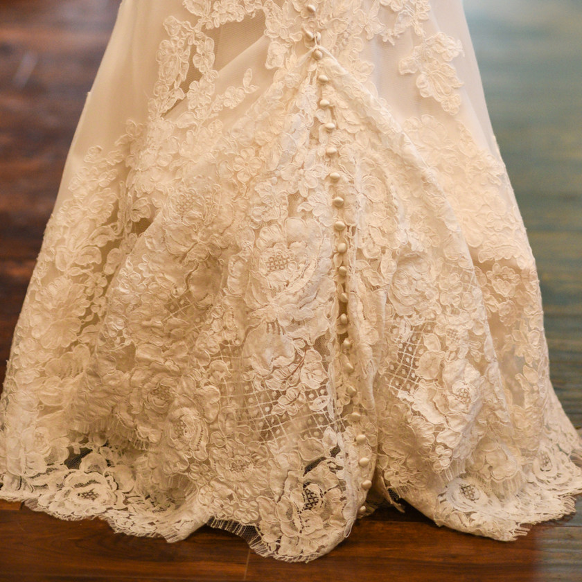 Wedding dress lace and button detail