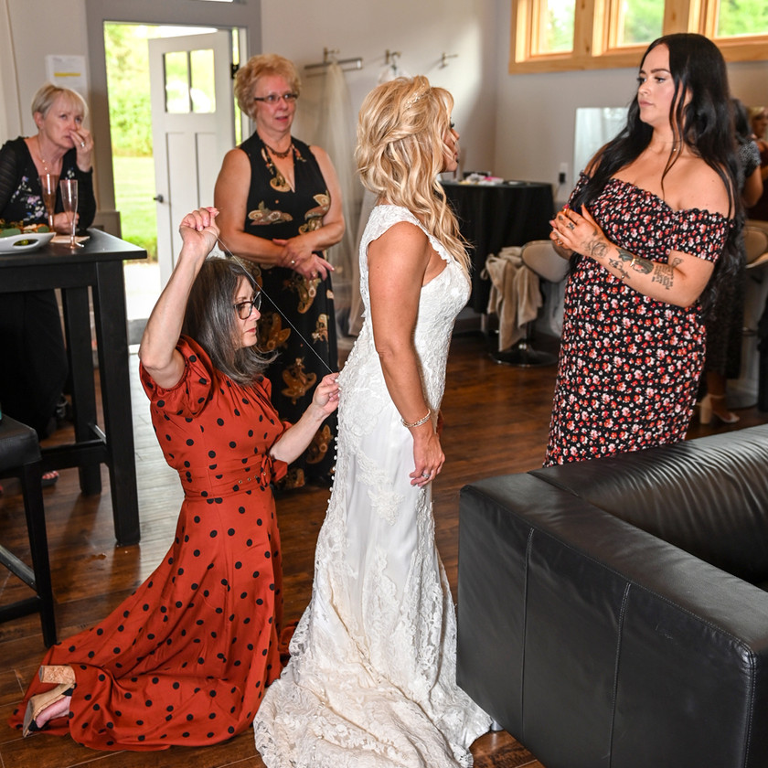 Helping the bride get dressed