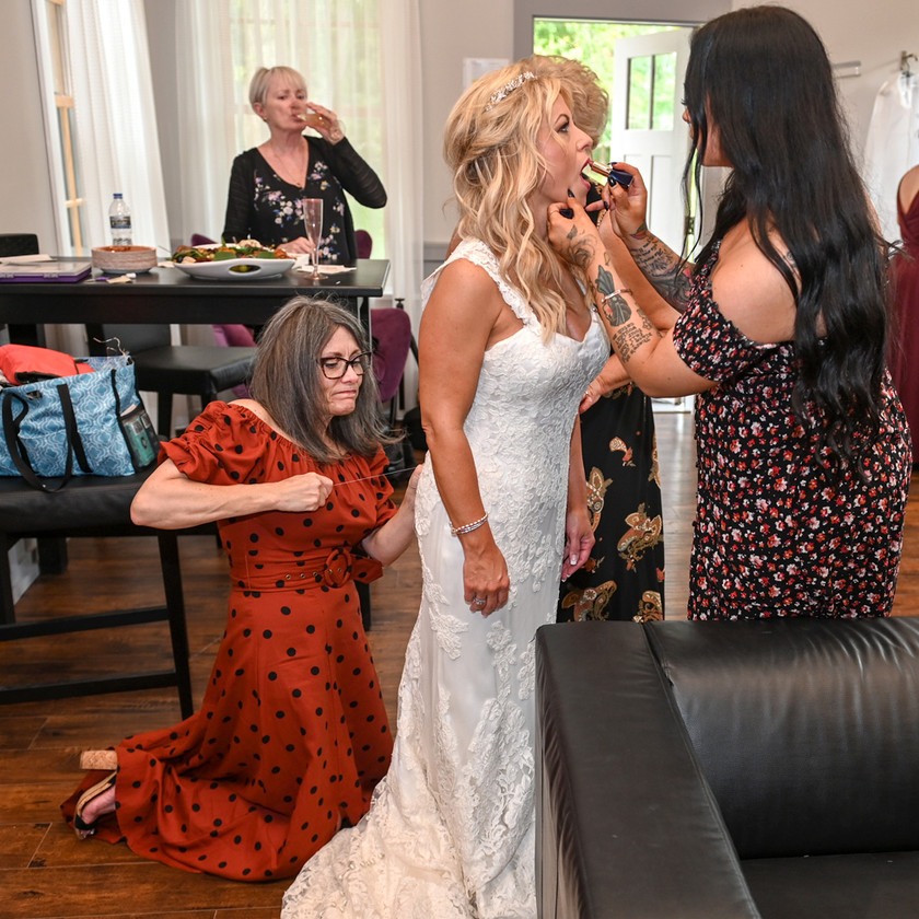 Helping the bride get ready for the wedding