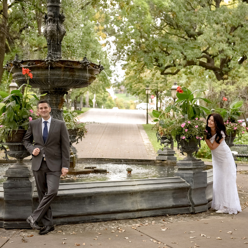 Bride and Groom 'First Look' by fountain in St. Paul, MN