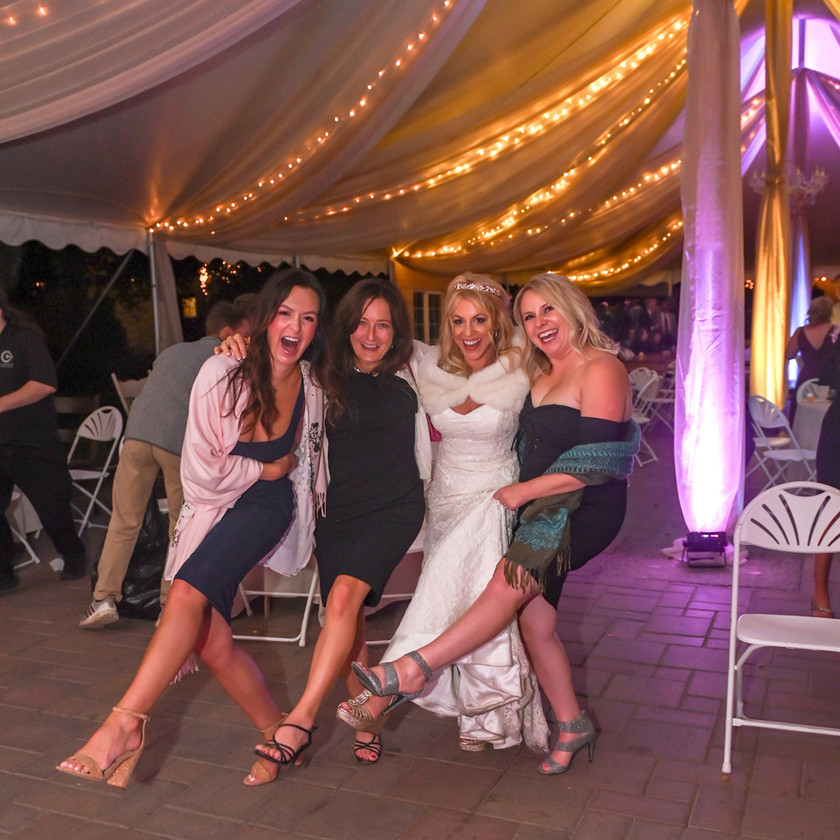 Bride and wedding guests kick up their heels