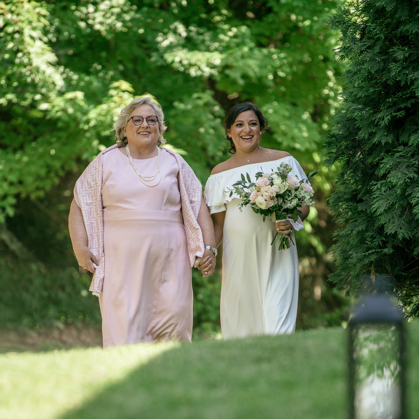Bride and her mother at small backyard wedding