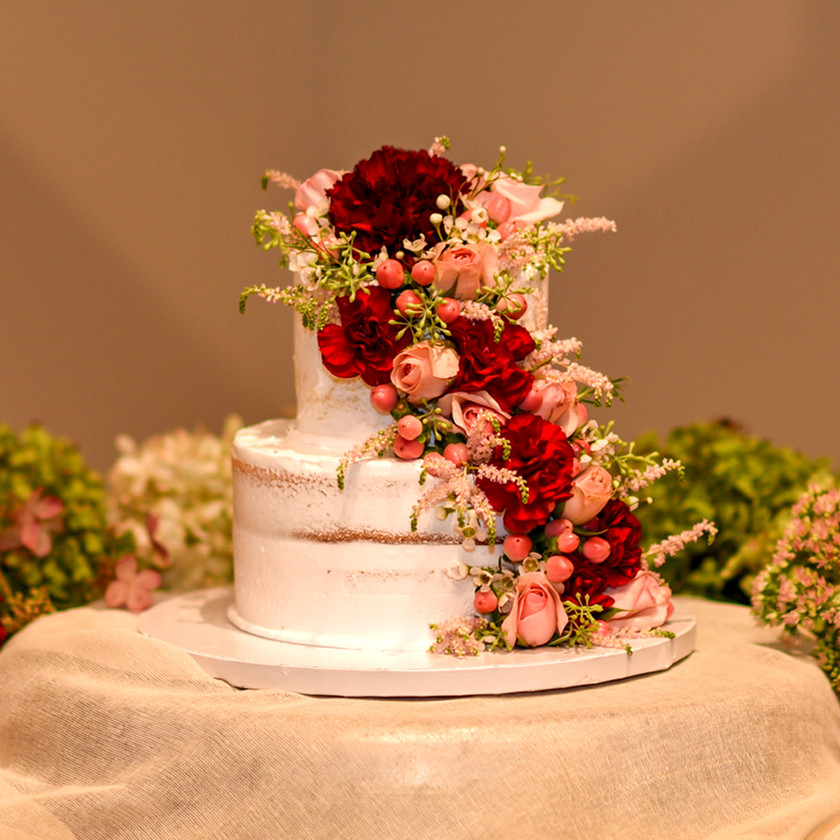 Wedding Cake with Red and Pink Flowers
