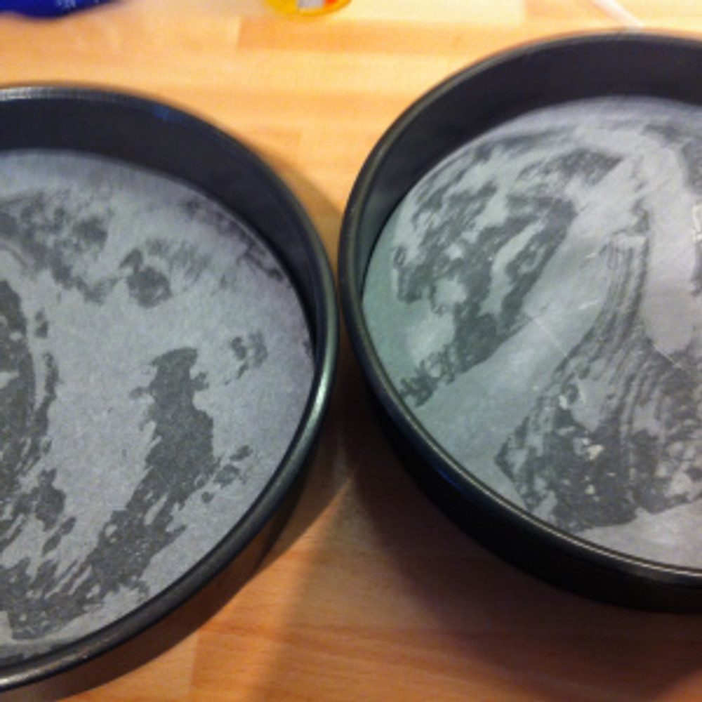 """Two 20cm/ 8"""" diameter cake tins were greased and lined with baking parchment circles."""