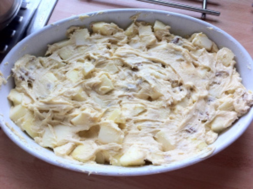 The mixture was then spooned into a greased baking dish.