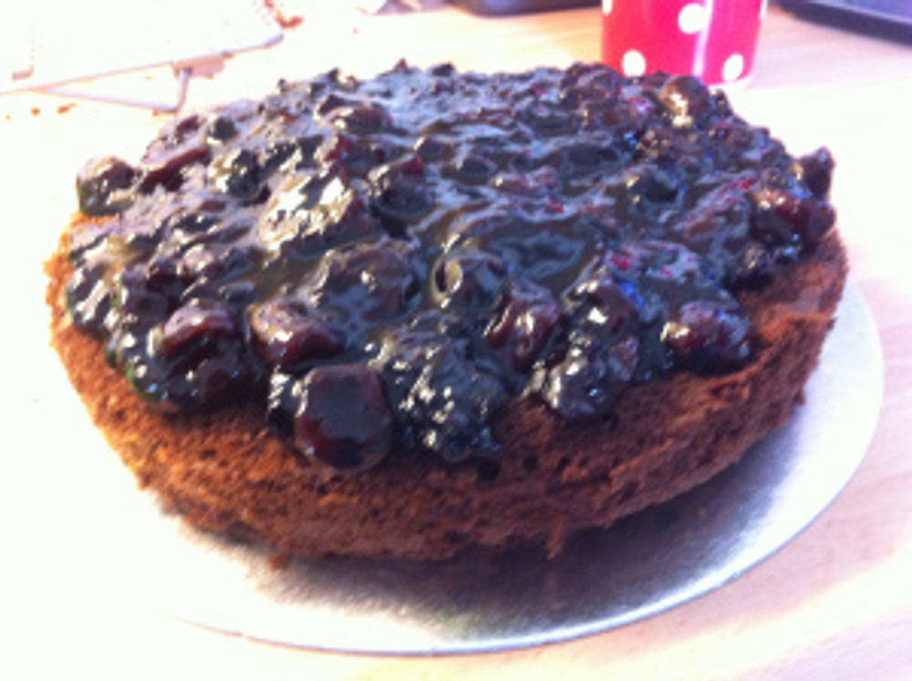 The black forest cherry filling was spread on top of one of the layers.