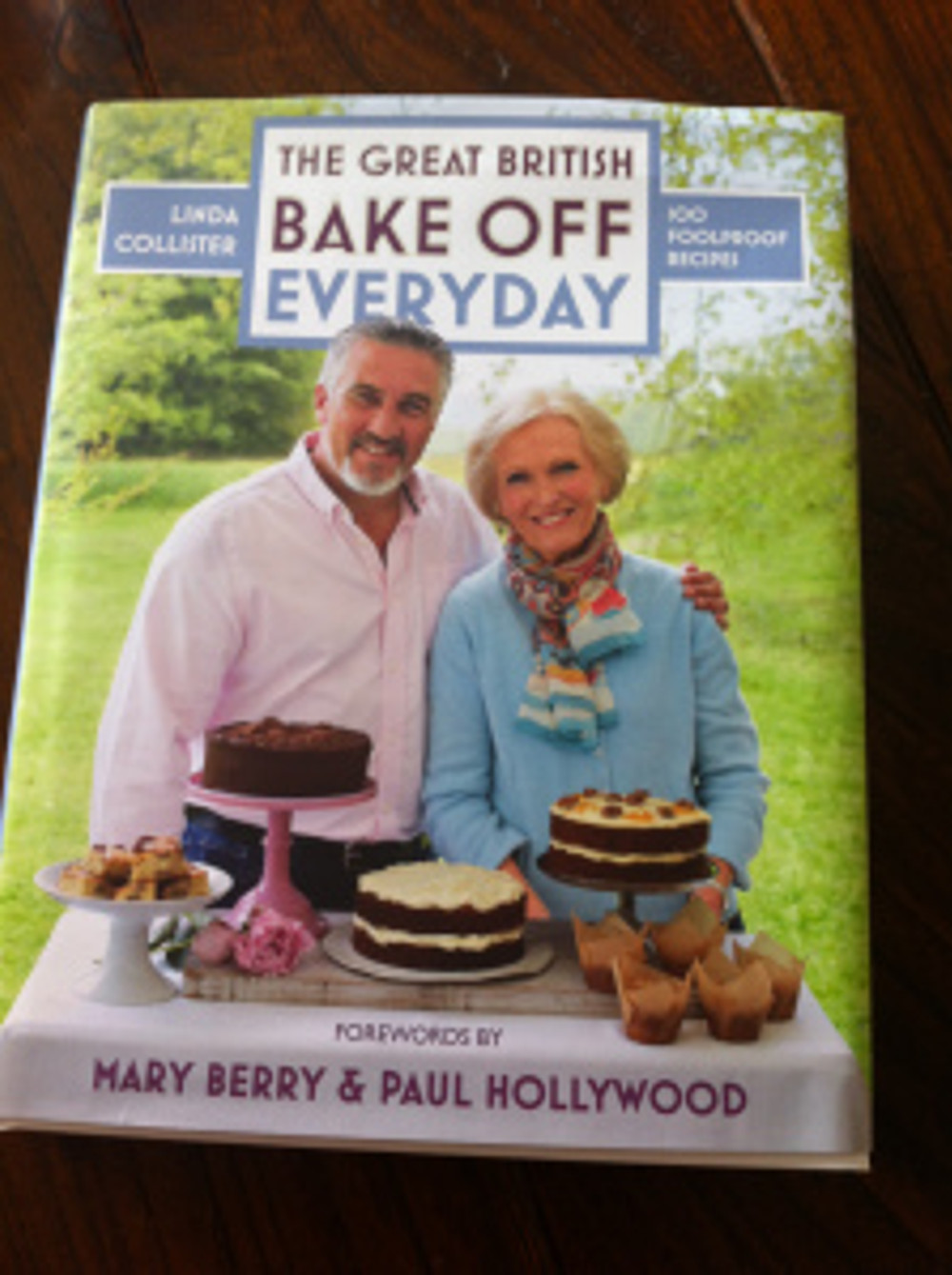 Front cover of the new GBBO Book with the judges: Mary Berry and Paul Hollywood.