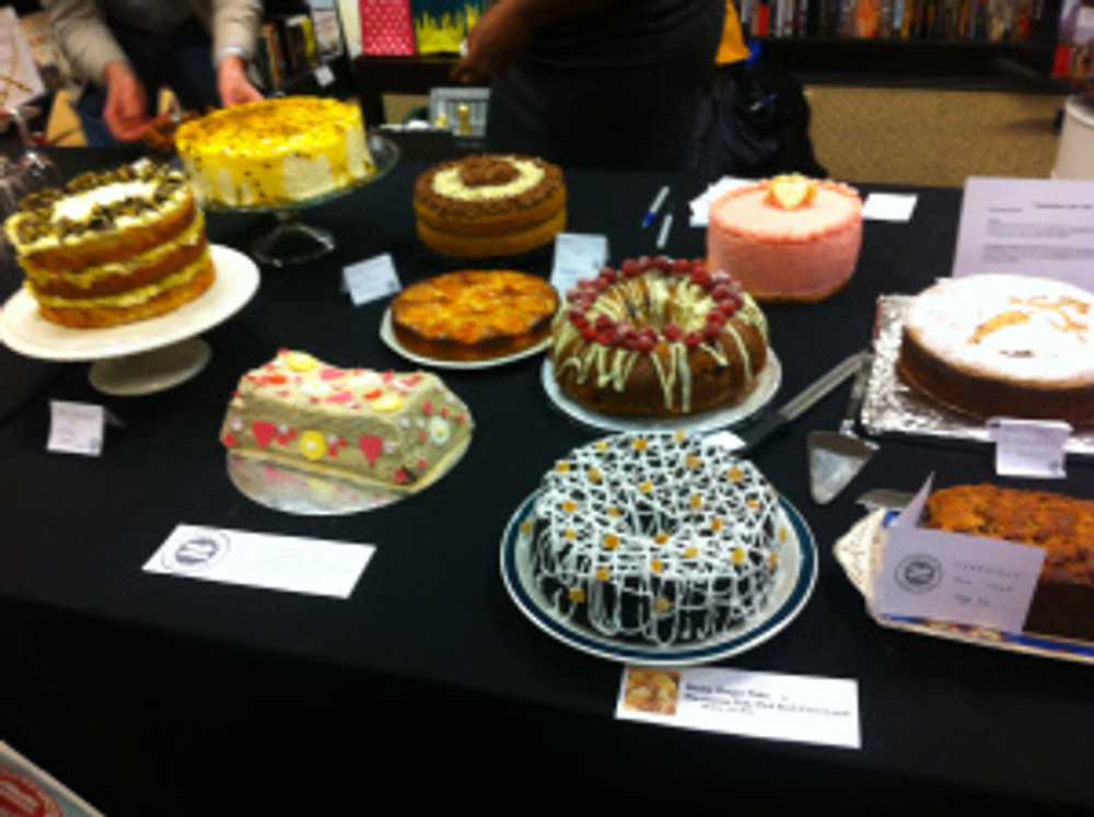 Two huge tables laden with cake.