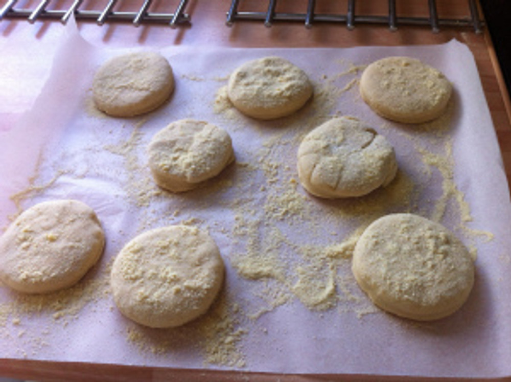 Some semolina was tipped onto a baking sheet and the muffins were dipped in this.