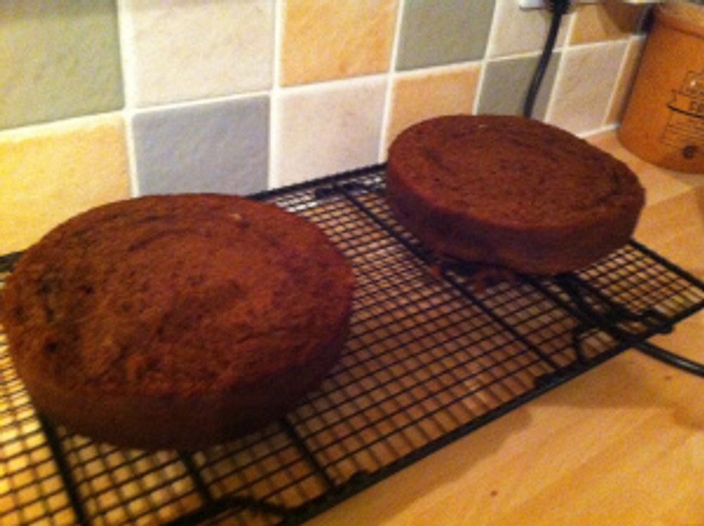 The chocolate cakes cooling on the rack.