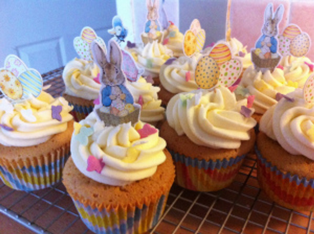 Vanilla cupcakes with vanilla buttercream frosting and finished with sugar butterfly sprinkles. Finished with Beatrix Potter cupcake picks from Lakeland Limited.