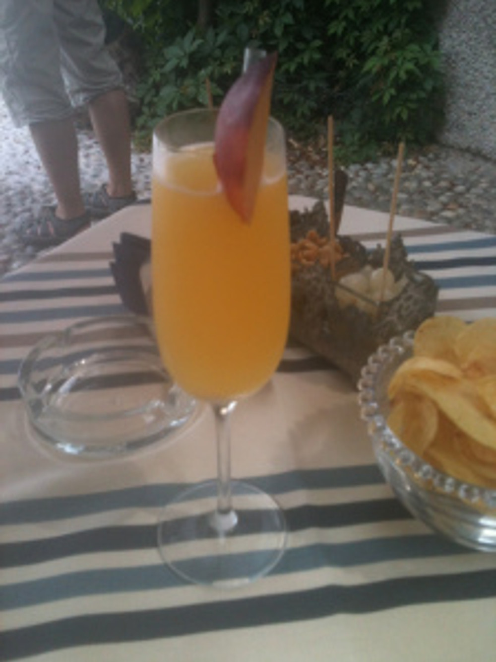 A celebratory Bellini sipped outside a cafe on the banks of Lake Como.
