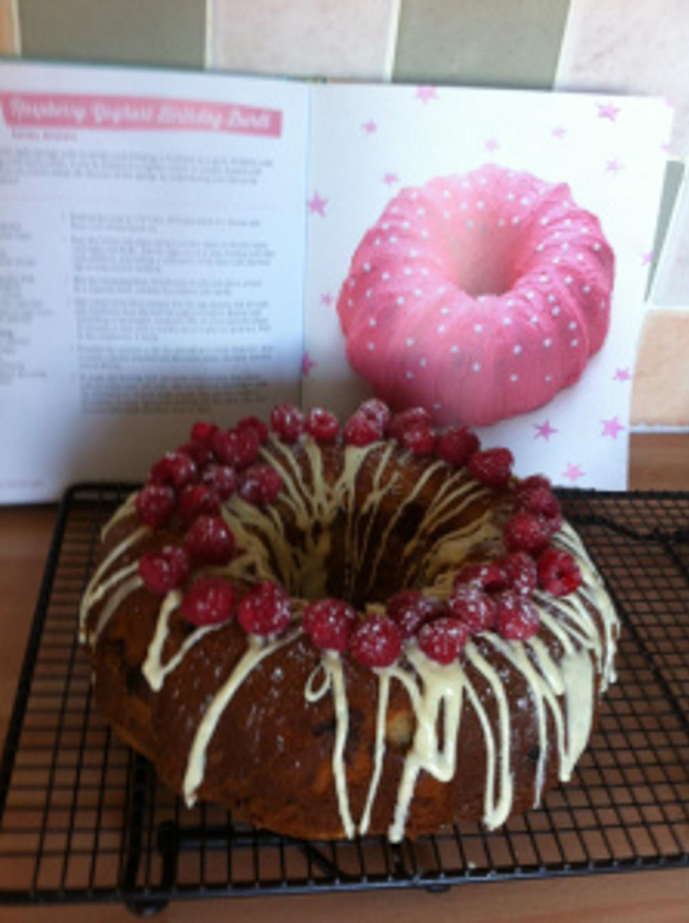 My version of Rachel McGrath's stunning Raspberry Yoghurt Bundt cake with her original recipe pictured behind!