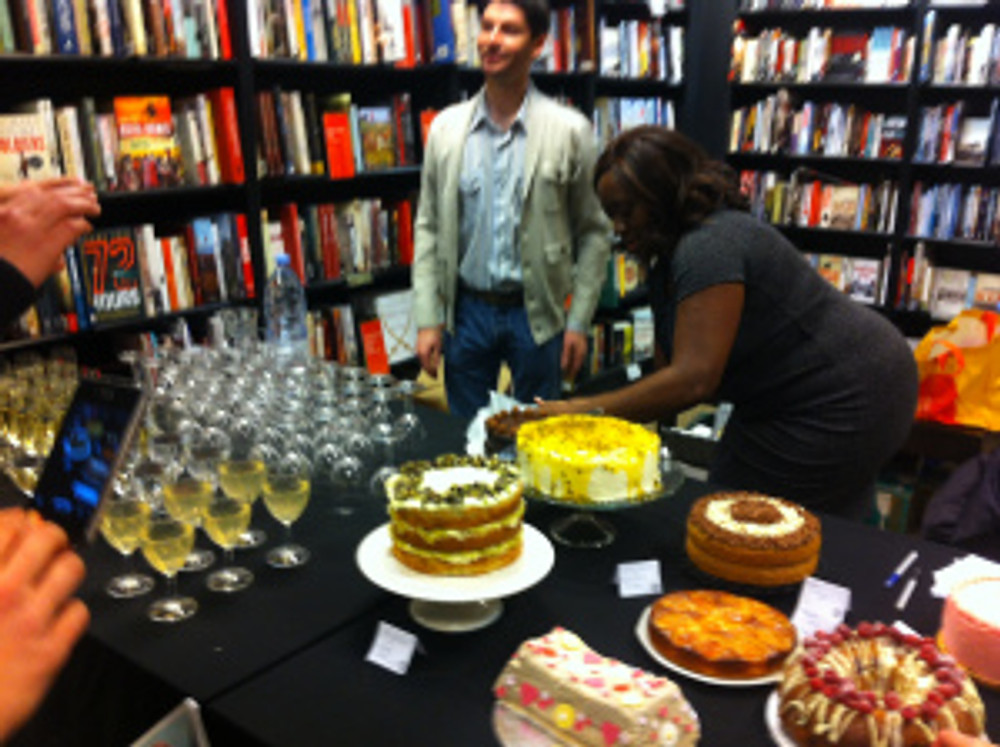 Everyone brought their cakes along and there were drinks all around.