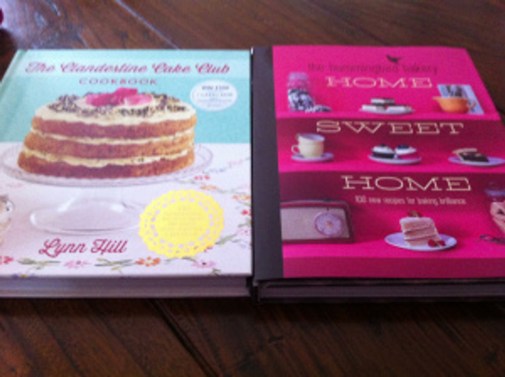 """My Clandestine Cake Club Cookbook (left) and the new Hummingbird Bakery """"Home Sweet Home"""" book on the right"""