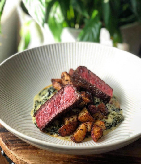 Ribeye & creamed spinach with duck day p