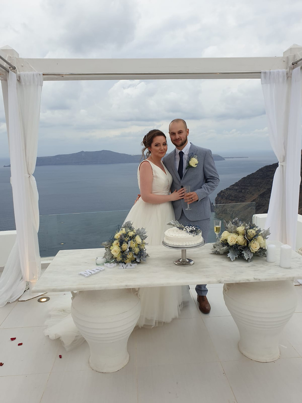 bride and groom on wedding day in santorini