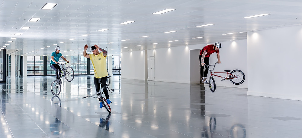 men doing tricks on bmx bikes indoors