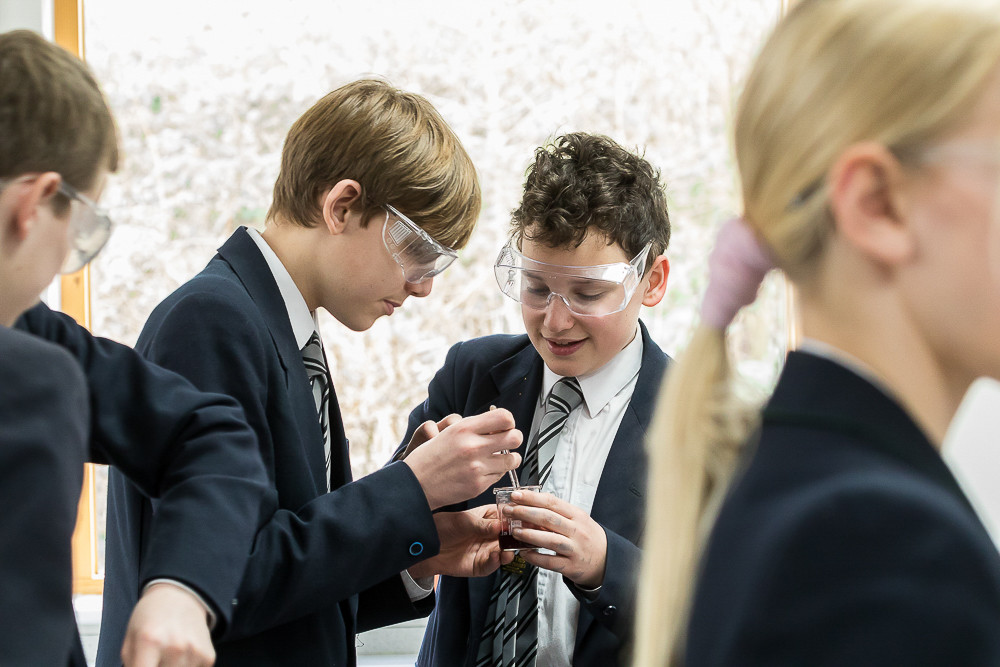 kids doing science experiment in school
