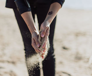 Hands in sand