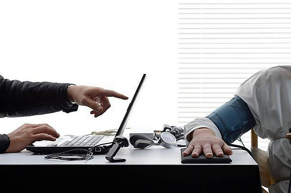 closeup-on-hands-and-polygraph-testing-e