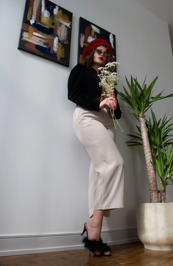 The beige pants are carefully constructed, well made.  The fabric, a 50% polyester, 50% silk crepe, provides breathability and durability, while having a great hand and drape without compromising the time and energy of a modern woman - they can be machine washed and dried.  They are slightly stretchy, hugging the curves, with binding on the inside made from silk sourced from India. While the pants are a wardrobe staple, they have special deitails on the inside that makes them special to the wearer.