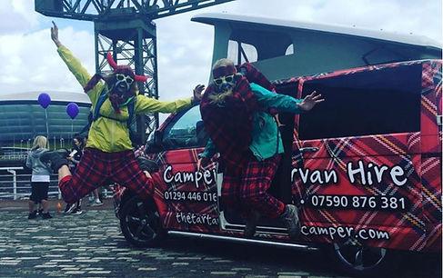 two people wearing tartan jumping in the