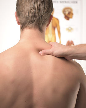 A Man's Back Getting Treated by a Chiropractor
