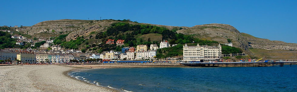 Llandudno North Beach with a view of Min y Don Guesthouse in the distance