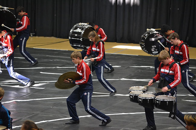 MVHS Winter Percussion Drummers and Symbol players during a performance