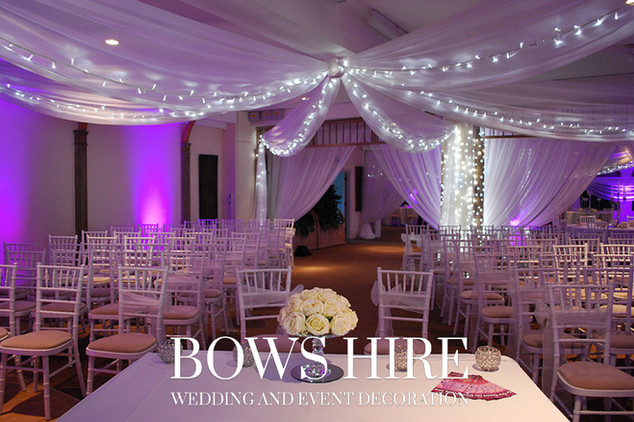 Vertical Ceiling Drapes with Fairy Lights and Uplighters