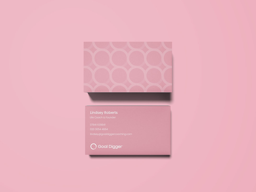 Branded business cards on pink background