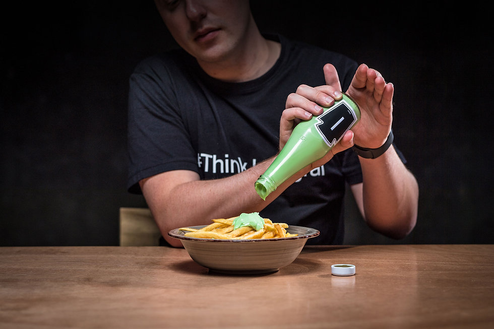 Integral team member Sam putting green ketchup on chips