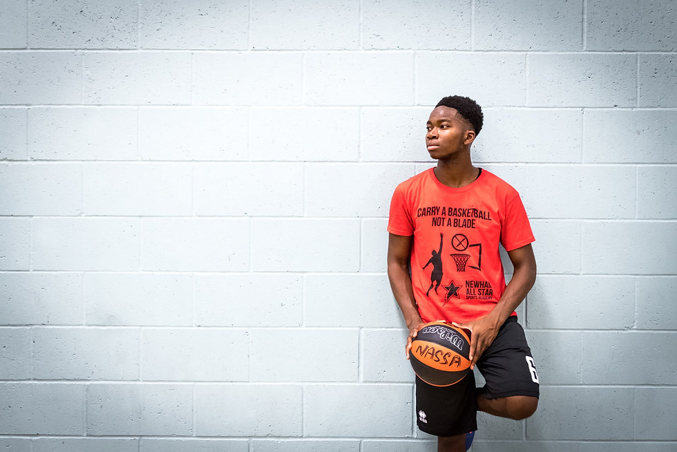 Portrait of young basketball player from London charity NASSA