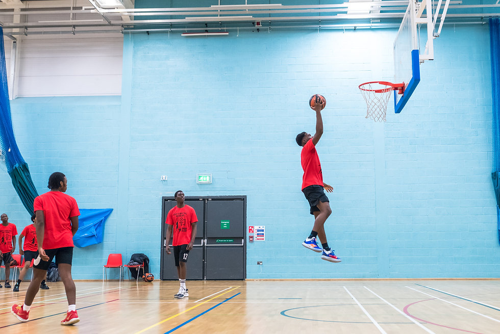 NASSA player jumping for the hoop