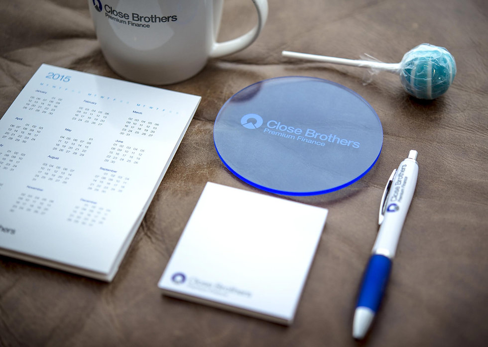 Branded items from the desk drop arranged