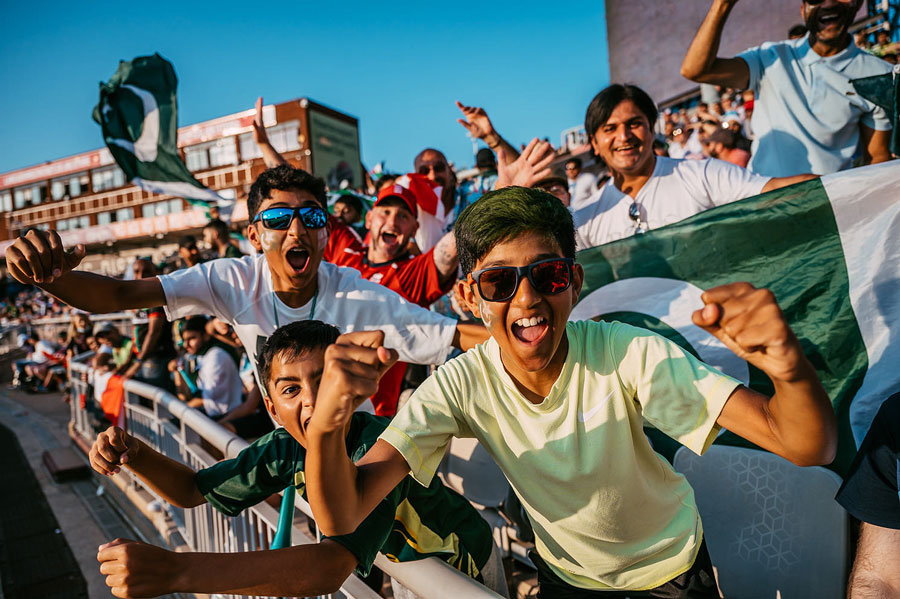 Young excited crowd members at a test match