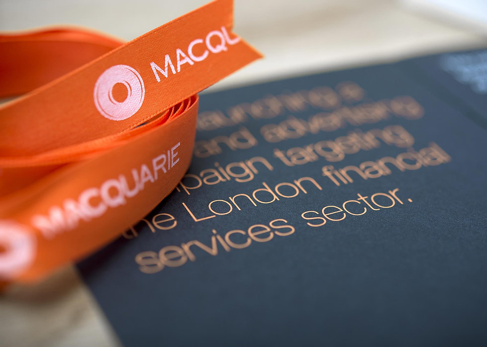 Close up of direct mail piece showing branded ribbon