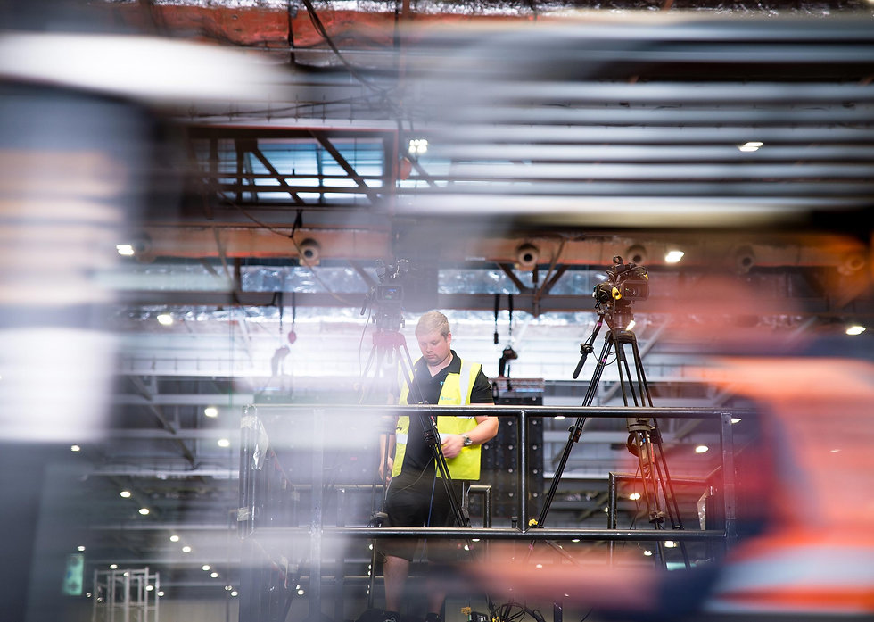 Shot of behind the scenes worker setting up camera equipment