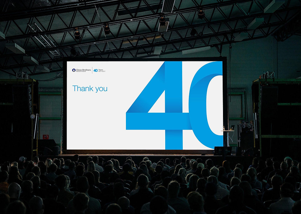 40 year campaign logo projected onto screen at company meeting